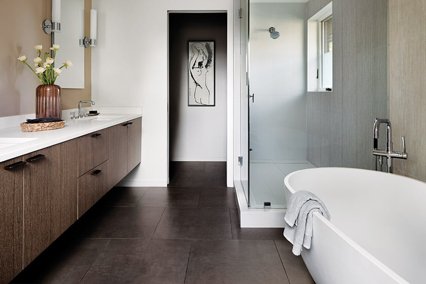 The master bath features flooring from Porcelanosa and a soaking tub.