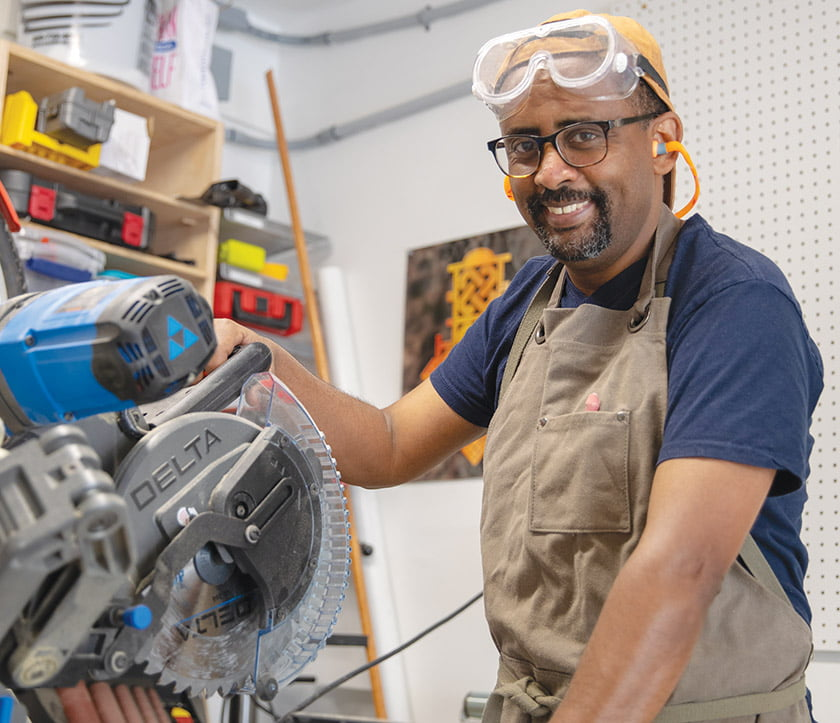 Jomo Tariku, in his Springfield, Virginia, wood shop.