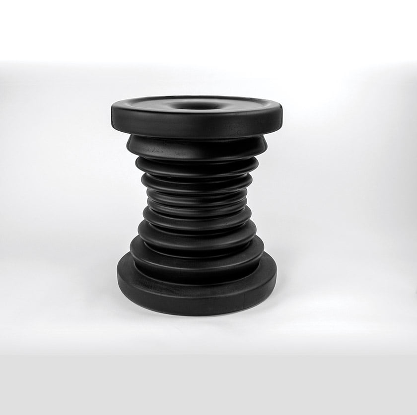 The lathe-turned Mukecha Stool riffs on the form of an African mortar, used with a pestle for grinding.