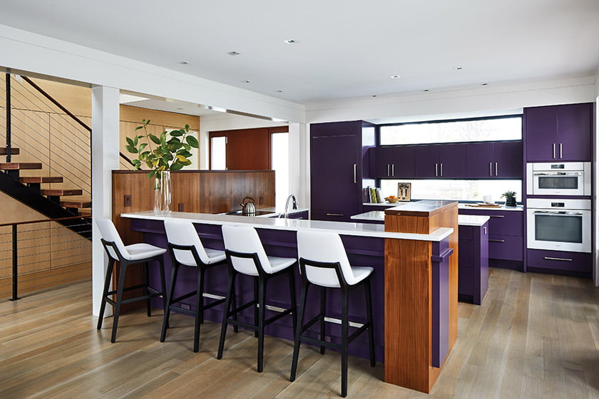 Designer Christie Leu selected Benjamin Moore Grappa, a bold purple hue, for the kitchen cabinetry.