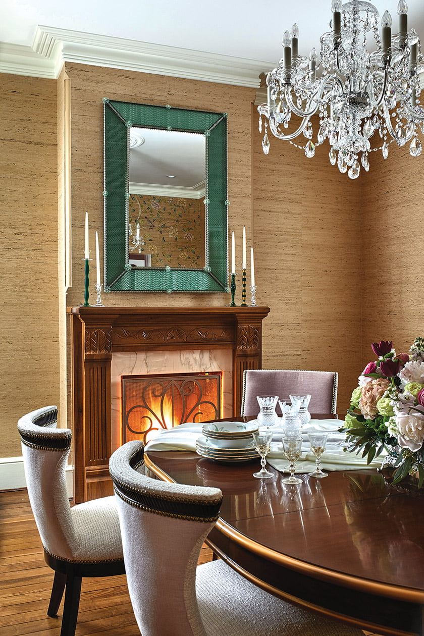 A Murano glass mirror hangs above the fireplace, faux-finished by Billet Collins to look like mahogany.