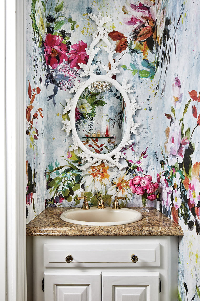 Osborne & Little floral wallpaper packs a punch in the powder room.