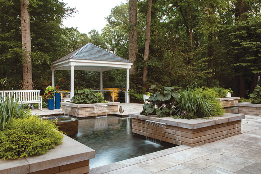 A pavilion offers a comfortable, shaded spot from which to enjoy the serene view.