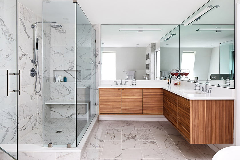 The finished space encompasses a roomy shower enclosure, soaking tub and wraparound vanity offering copious storage.