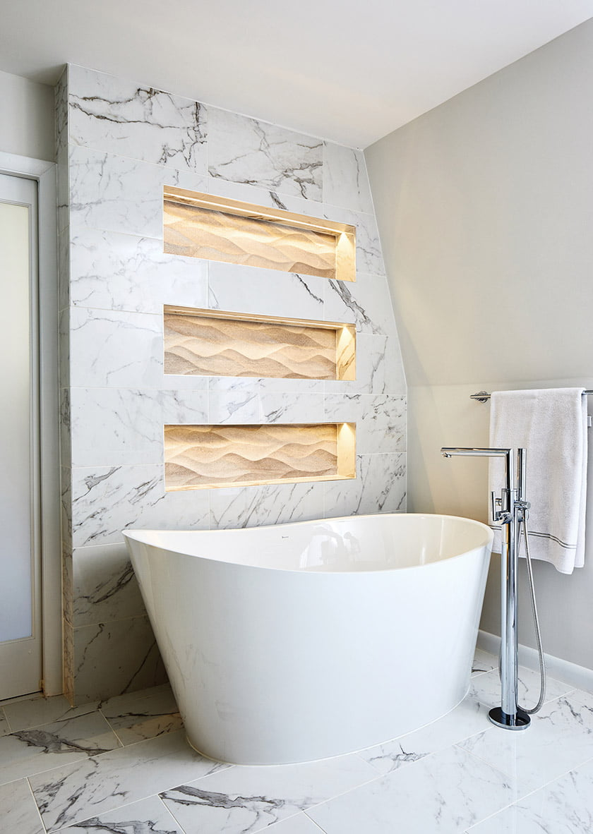The freestanding tub is by BainUltra.