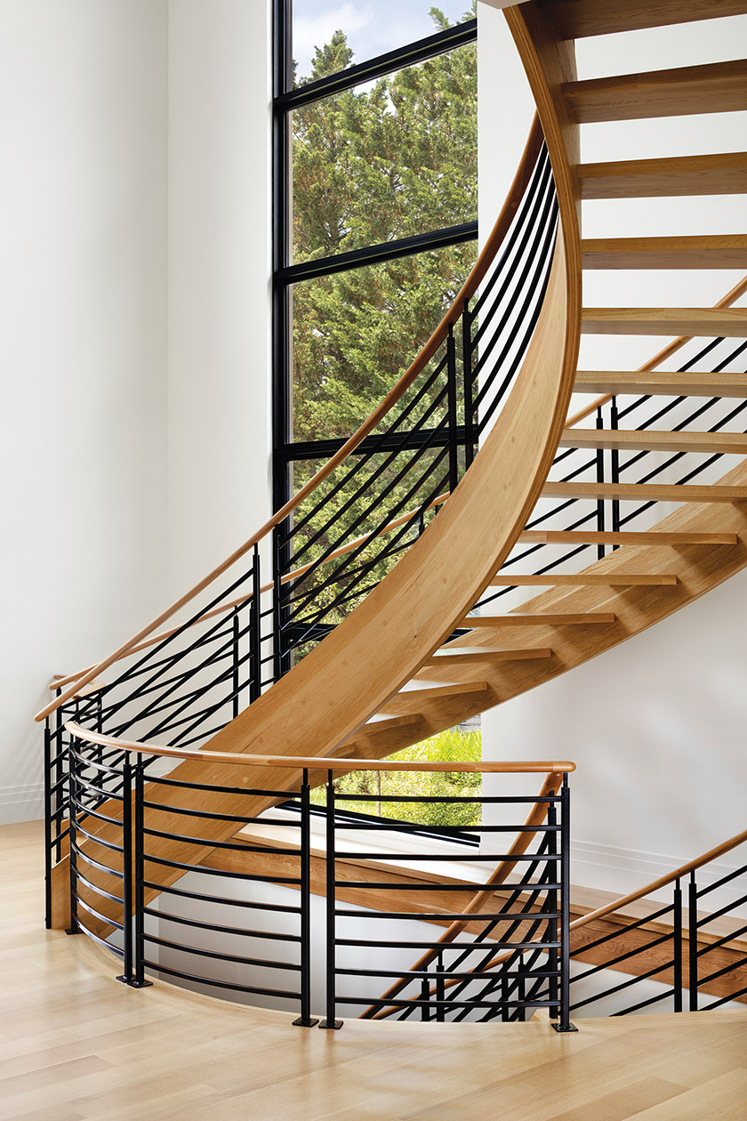 Devin Kimmel, AIA, ASLA, designed a curved iron-and-oak staircase as a focal point in a modern home in Annapolis.