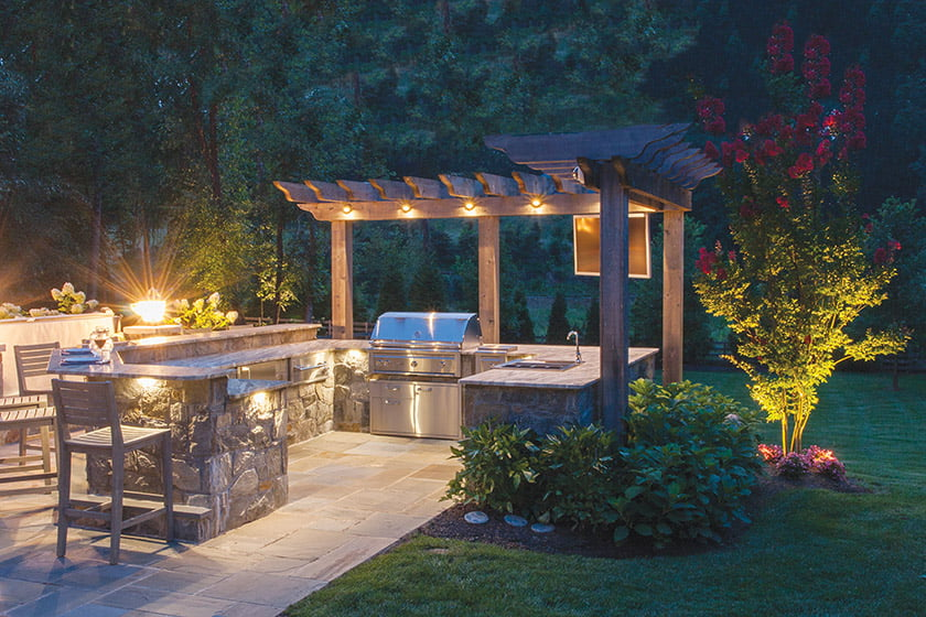 Wheat's Landscape designed an outdoor kitchen in McLean complete with a built-in grill, sink and bar-height counter.