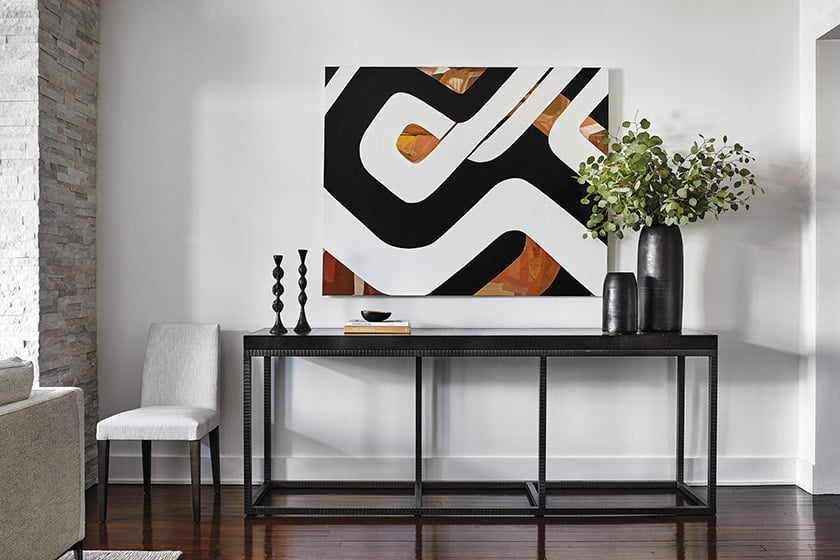 A painting by Washington artist Jorge Caceres hangs above a console by Iatesta Studio in the living room.