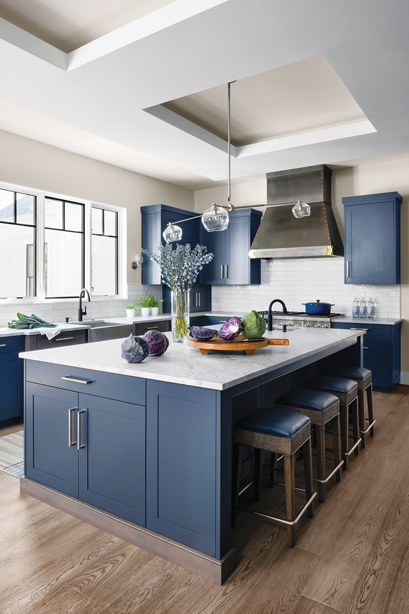 Navy cabinetry and white engineered-stone countertops create clean, crisp style.
