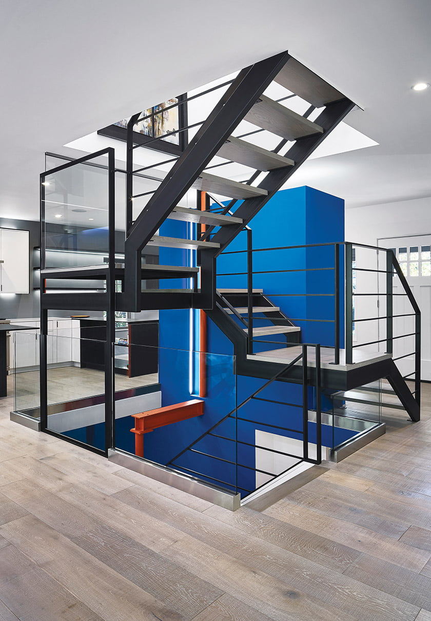 A steel staircase is a central feature of the remodeled home.