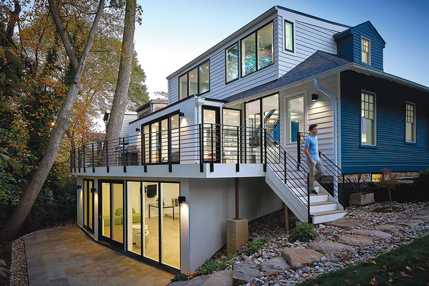 The back of the house reveals the transformation, with a patio that's accessible from a lower-level rec room.
