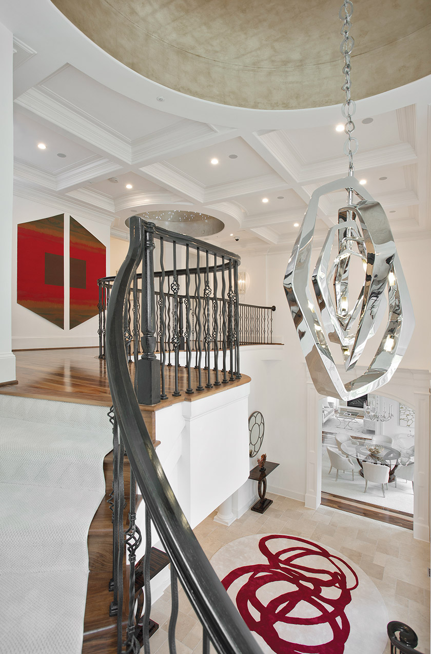 Barbara Hawthorn hung a diptych by Paul Reed on the upper landing in a grand Bethesda home.