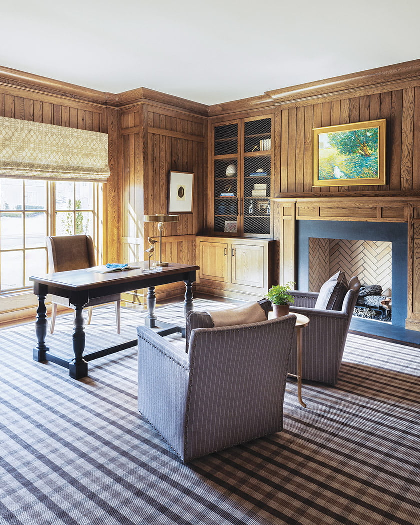 A bespoke rug from Carpet Creations gives the study its masculine feel.
