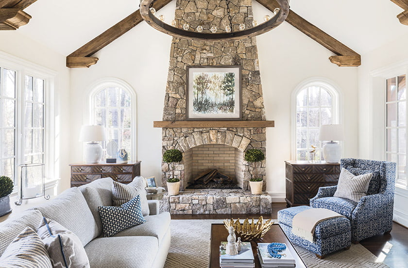 Rustic architectural details in the family room inspired Penno's earth-toned palette throughout.