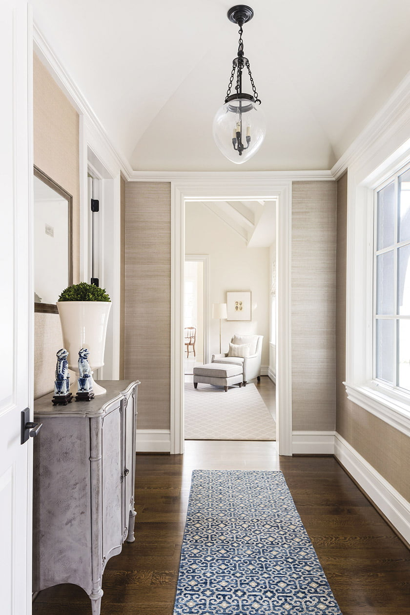 A Kellogg Collection runner brings pattern and color to the master-suite vestibule.
