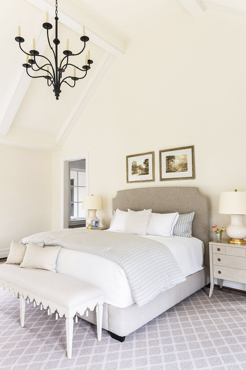 In the bedroom, hand-painted nightstands from Tritter Feefer flank a Serena & Lily bed.