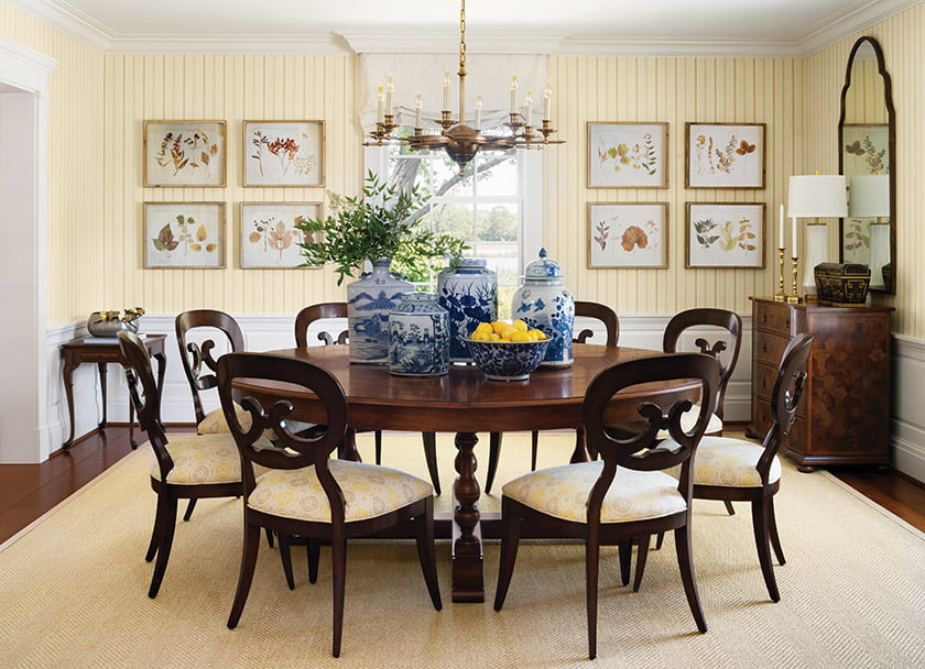 The dining room centers on a Sarreid Ltd. table and chairs from Woodbridge Furniture.