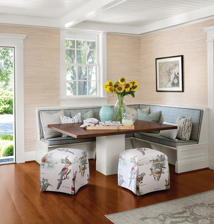 Custom cushions grace the built-in banquette in the kitchen.