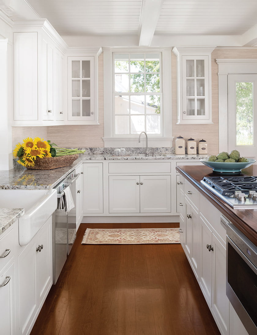 In the kitchen, a shiplap-style ceiling is reminiscent of a boat galley.