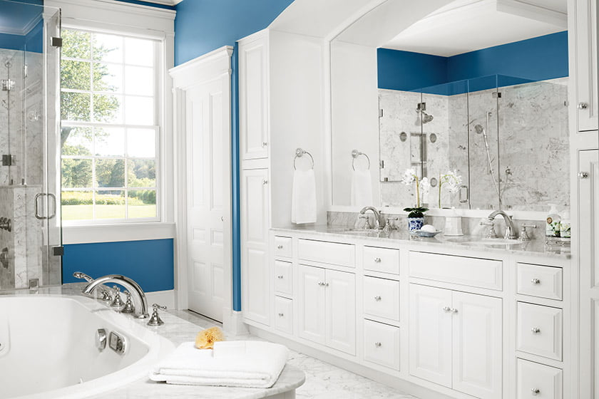 Three kinds of Carrara marble were employed to give the owners' bathroom interest and depth.