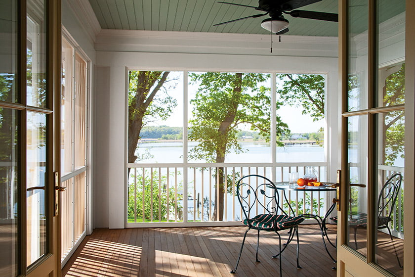 The screened porch was designed as an extension of the kitchen/family room space; stained ipe clads the floor.