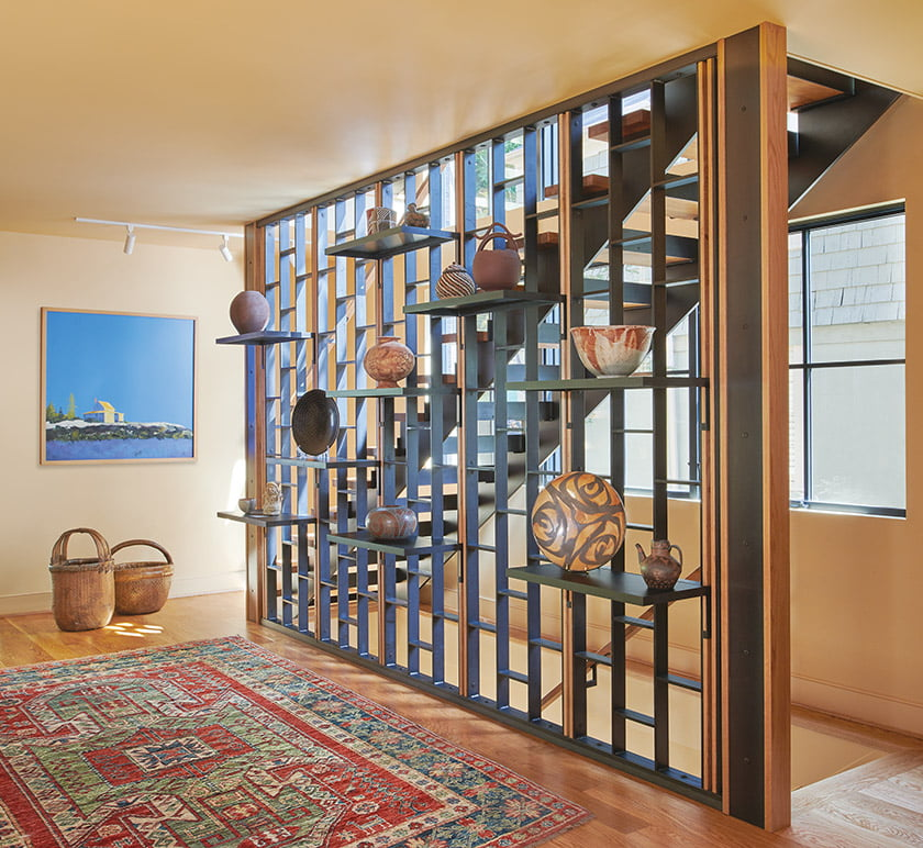 Gutierrez Studios fabricated and installed the dramatic wood-and-steel staircase and its accompanying screen wall.
