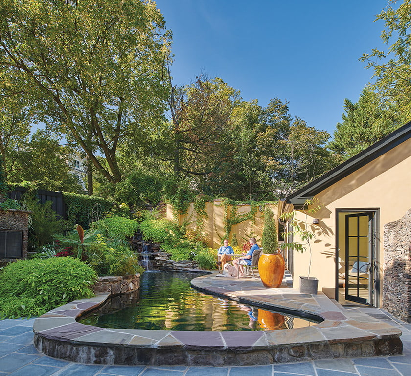The owners relax by the pool and pool house, which were overhauled during the renovation.