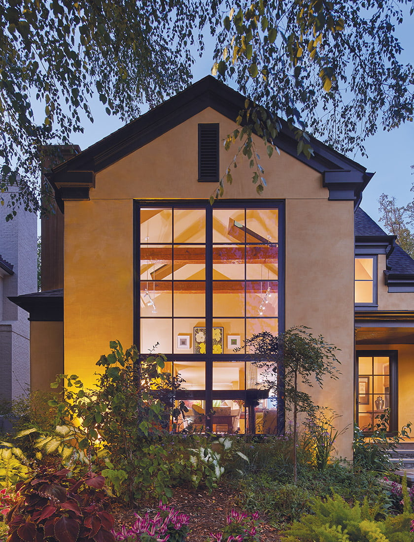 The renovation preserved the existing front living room and its gabled roof, part of a 1980s addition.