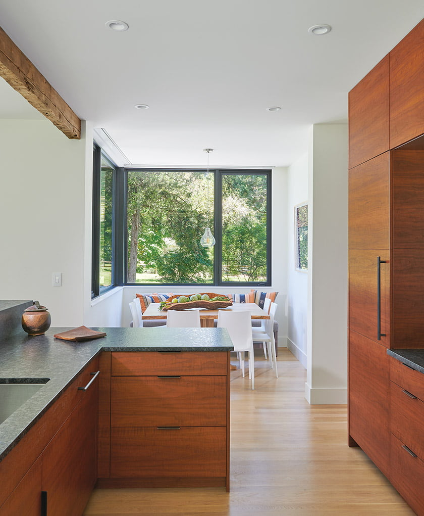 Designer Vivian Braunohler selected an elm-slab table for the breakfast nook.