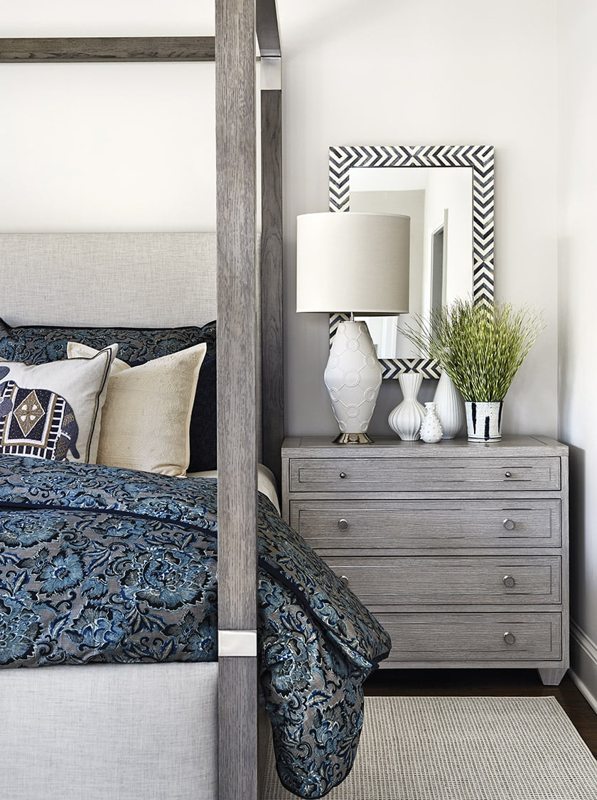 A four-poster bed and nightstands from Bernhardt create sophisticated warmth in the owners' bedroom.
