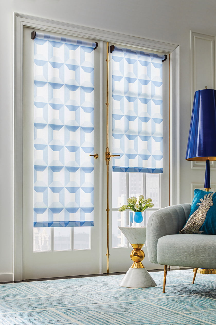 French doors are dressed in roller shades sporting a playful Jonathan Adler pattern for The Shade Store.