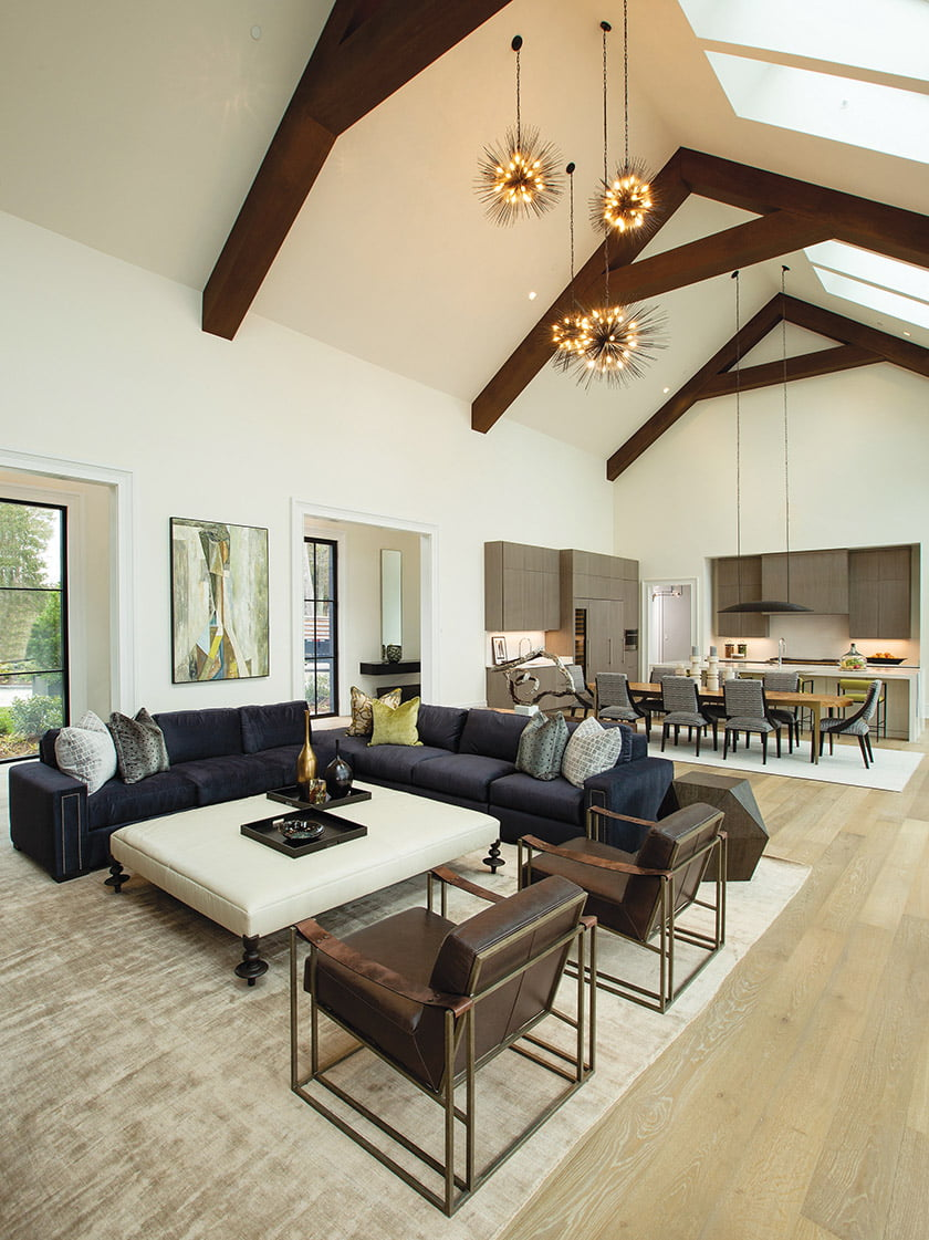 Comfortable seating anchors the living area beneath pendants resembling dazzling sea urchins.