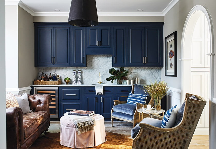 The entryway opens into a new wine room featuring striking navy-blue cabinetry.