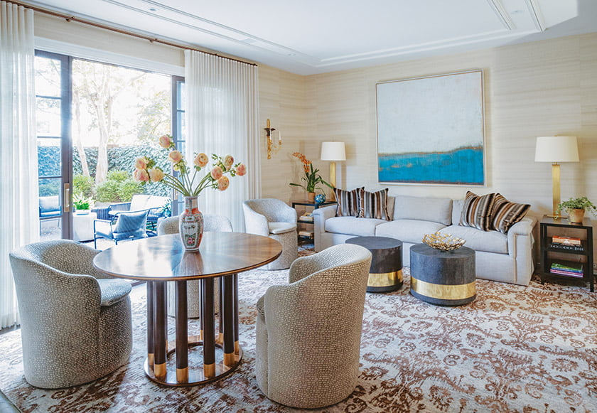 Brass accents on the table by Keith Fritz and the Made Goods drum tables lend the family room a touch of glam.