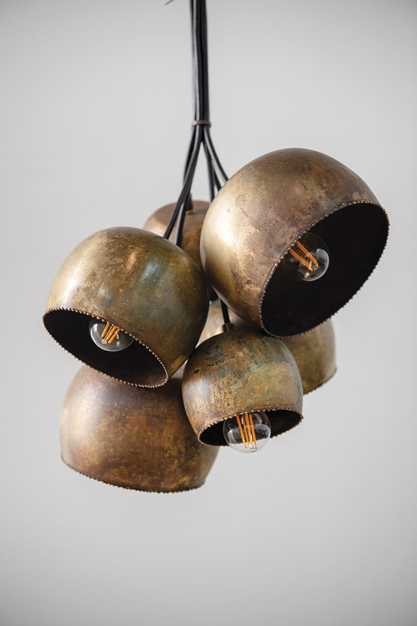 One recent fixture was fabricated from repurposed brass bowls.