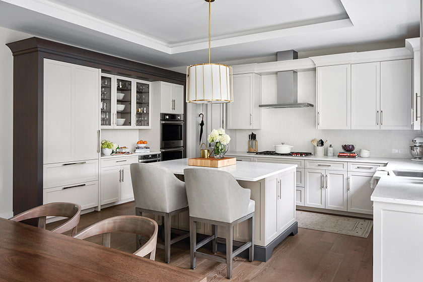 Over the kitchen island, Morris hung a Visual Comfort drum pendant from Circa Lighting.