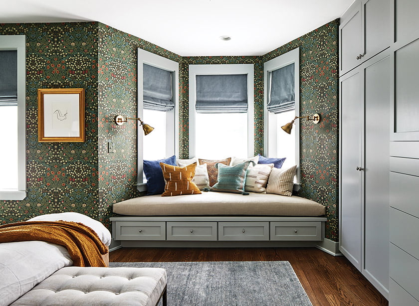 Feldman commissioned built-ins facing the bed and a deep window seat in the bay.