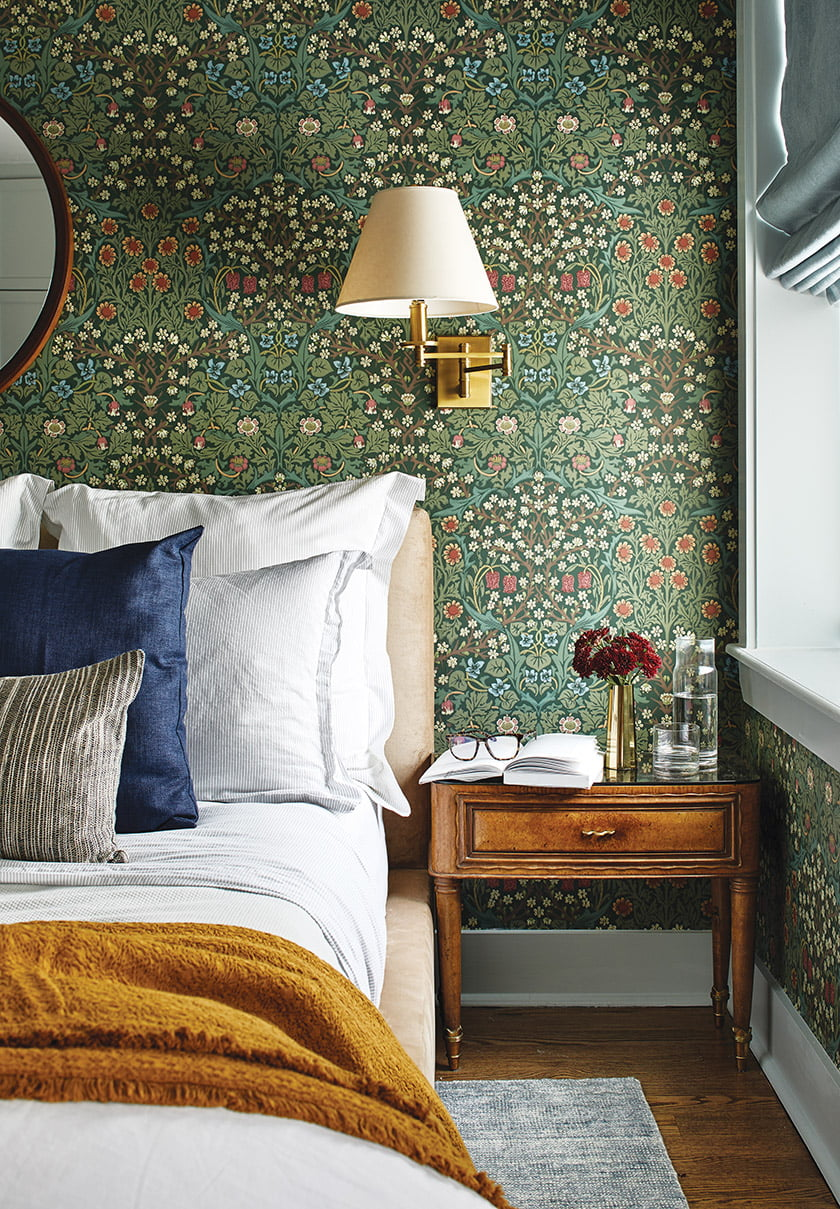 Wallpaper by 19th-century design icon William Morris envelops the owners' bedroom.