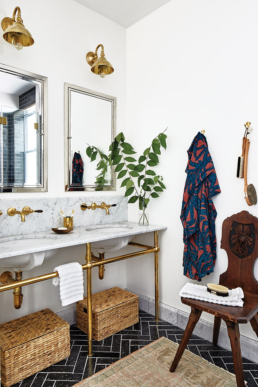 A Waterworks washstand in brass and marble imparts a vintage feel.