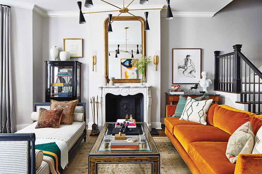 A Baker sofa designed by Kara Mann in performance velvet faces a vintage daybed in the living room.