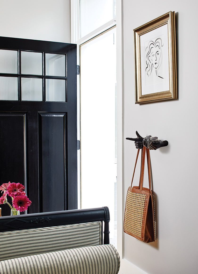 A sketch by Tenley Masson, who works at Zoë Feldman Design, hangs near the front door.
