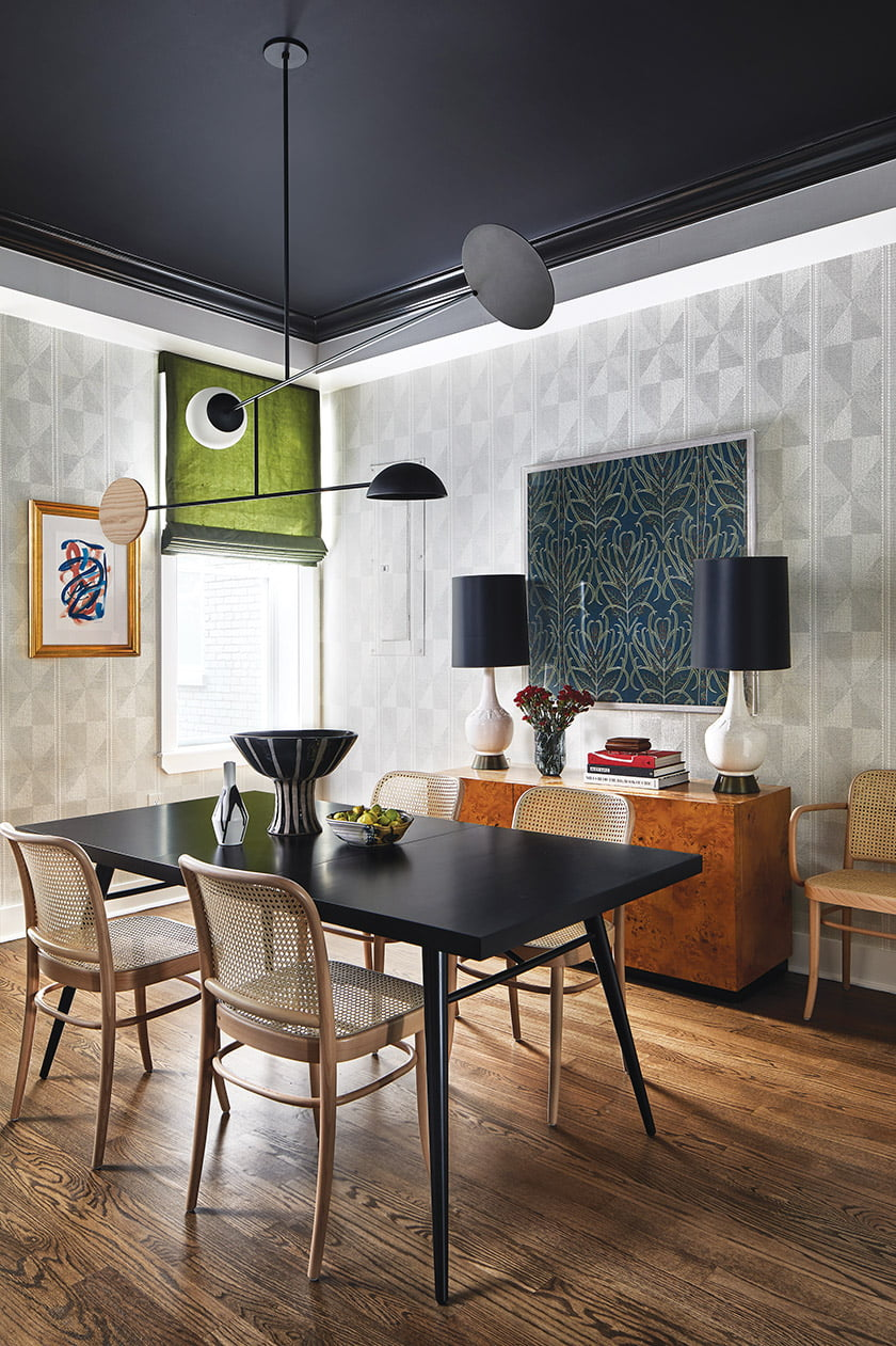 Pierre Frey geometric wallpaper drove the design of the dining room; a mobile-like chandelier hangs above the dining table.