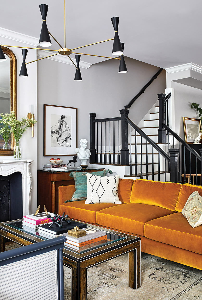 The stair rail was painted black to connect with other black elements in the room.