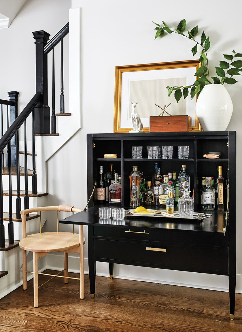 A bar cabinet from AVE is paired with an Iatesta vase and a Gene Davis lithograph.