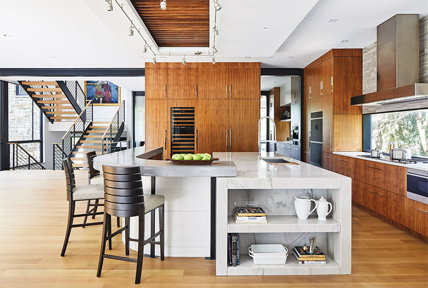 The main level features a kitchen with rift-walnut cabinetry and quartz countertops.