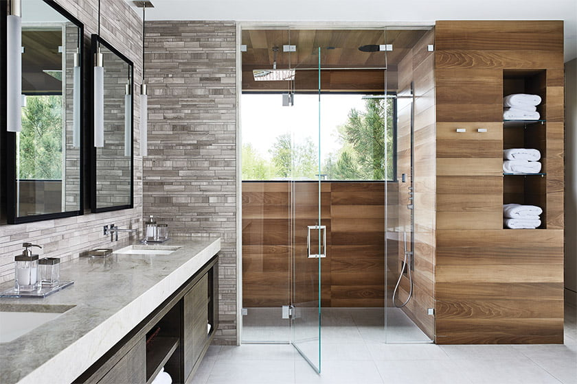 The owners' bath combines wood- and stone-look porcelain wall tiles for a spa-like effect.