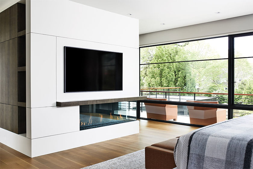 A central core in the owners' bedroom houses a TV and linear gas fireplace.
