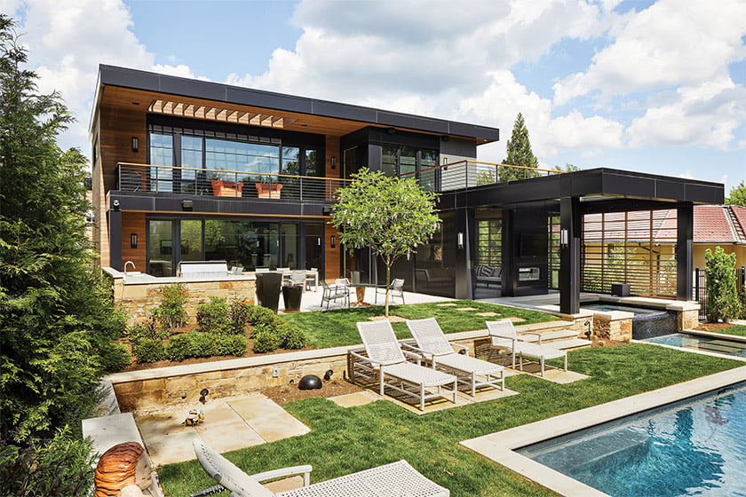 Designed by Mark Kaufman of GTM Architects, a home in Bethesda built by Sandy Spring spills out to a terraced backyard by Fine Earth Landscape.