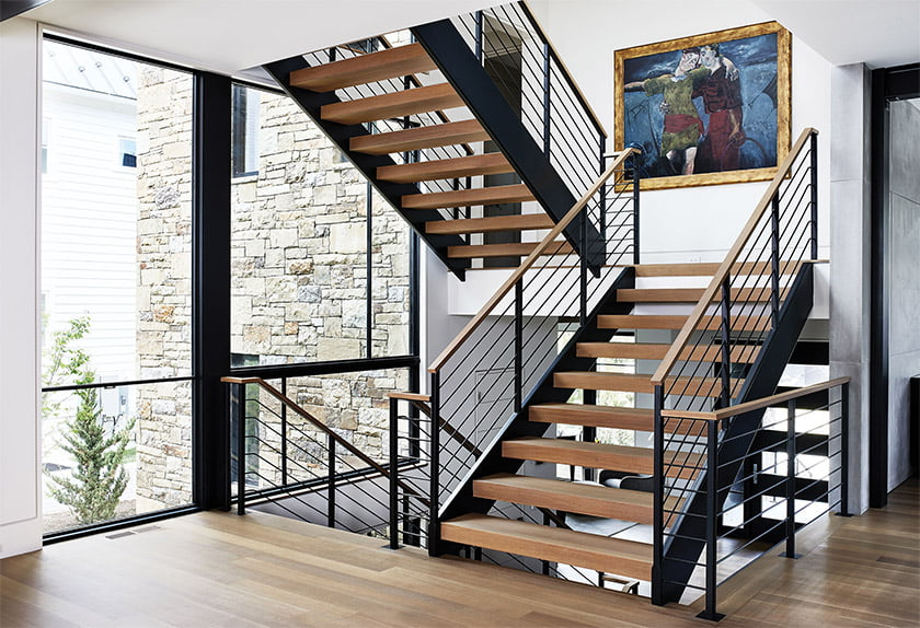 Three stories are connected by a rift-white-oak-and-steel stair with open risers.