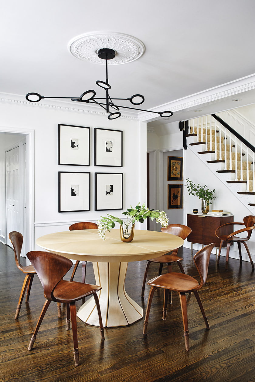 A round, entry hall-style table can be extended to host dinner parties in the dining room.